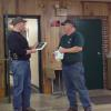 Ken Day accepts the 4-H Club plaque from Sam Detwiler.